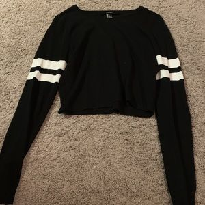 Black cropped sweater with white varsity stripes